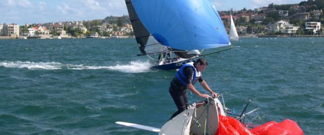 12-foot skiffs - one charging, one capsized...