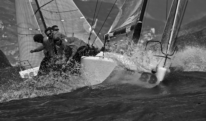 Melges 32 fleet battling upwind at Lake Garda