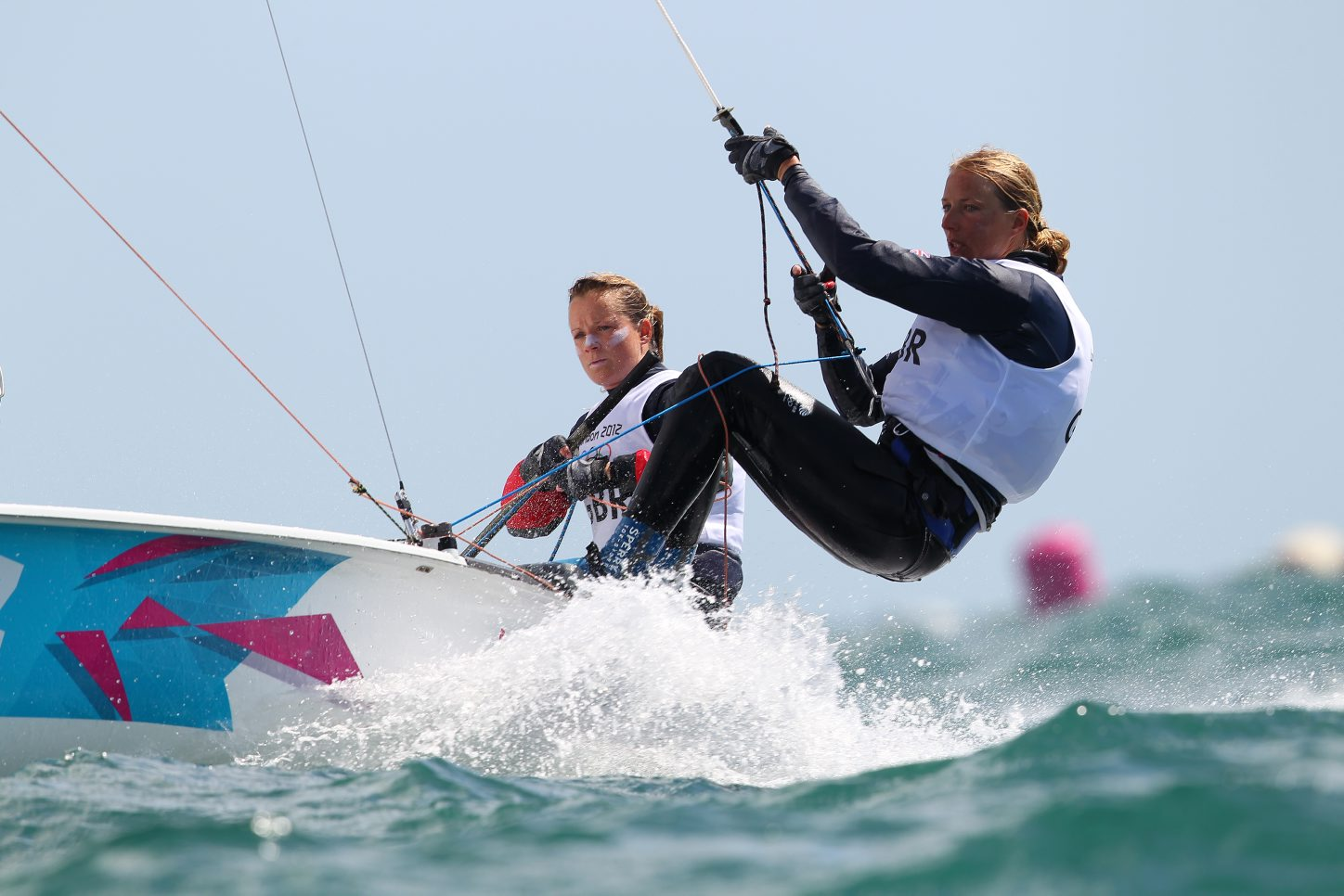 Hannah Mills (left) sails to silver with Saskia Clark