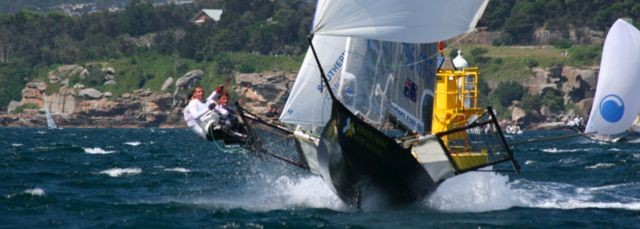 18-foot skiff galloping down Sydney Harbour