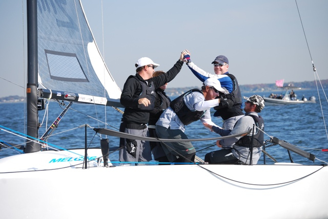 Terry Hutchinson high-fiving after a Melges victory
